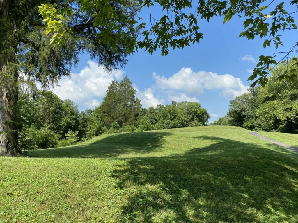 Grass covered Native American Burial Mound on a beautiful summer day.