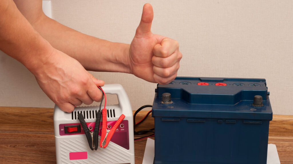 An RV battery is safely stored outside of the RV and in the house to stay warm and dry for the winter.