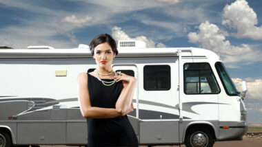 A luxurious woman stands in front of her RV.